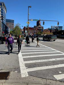 Image of people walking in crosswalk