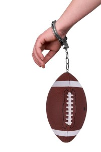 Football-and-handcuffs-201x300
