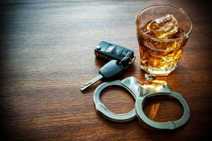 Whiskey-keys-and-handcuffs-300x200